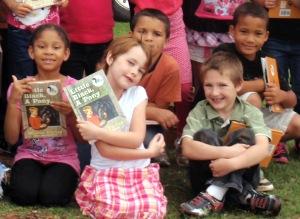 Highland Park First Graders get books